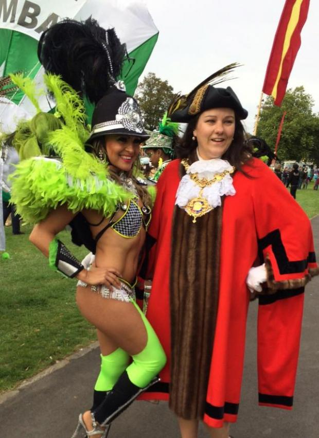 This Is Wiltshire: Mayor Sarah Bridewell makes a samba-dancing friend at Devizes Carnival