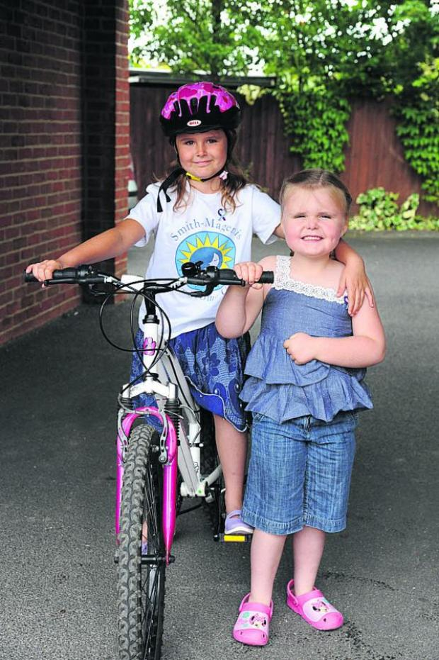 This Is Wiltshire: Emily Gunning, eight, and sister Jessica, six. Picture by Trevor Porter