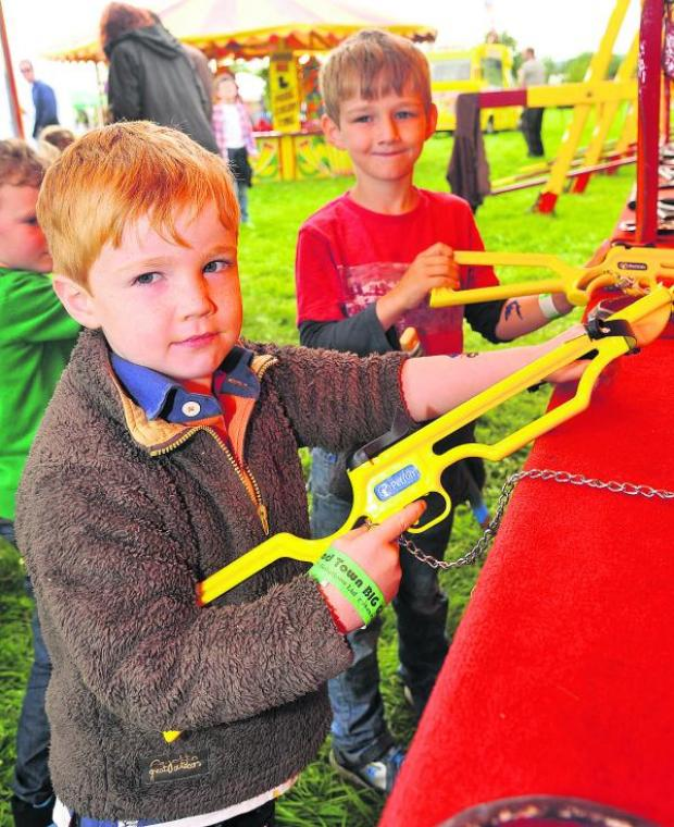 This Is Wiltshire: At the  Big Gig event in Broad Town are Harry and Ollie Peck. Pictures: Vicky Scipio