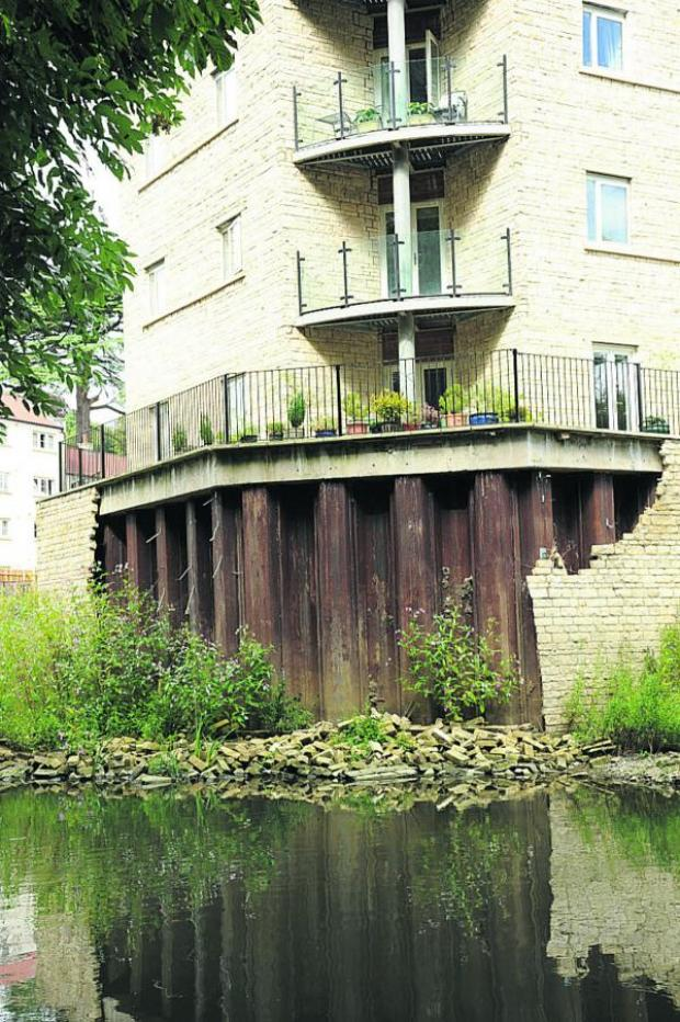 This Is Wiltshire: The collapsed wall that has yet to be repaired at Kingston Mill