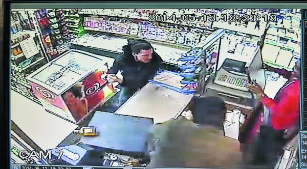This Is Wiltshire: CCTV captures the moment Luke O'Brien brandishes a knife before jumping over the counter
