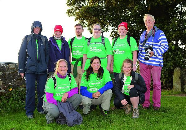 This Is Wiltshire: Employees from npower's Swindon headquarters who trekked 26 miles along Hadrian's Wall in aid of Macmillan Cancer Support
