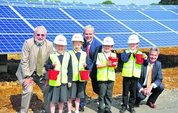This Is Wiltshire: Children from South Marston School opening Sevor solar farmin  South Marston. From left,  Coun Barry Thunder,  Phoebe, Lily, Peter, Paul Weeda, a director of Eneco Solar, Toby, Jamie and  Guy Madgwick a director Eneco