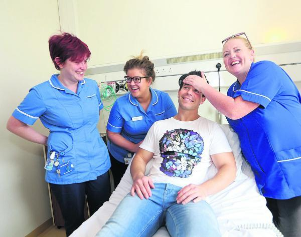 This Is Wiltshire: Coronation Street  doctor Oliver Mellor receives some tender loving care from midwives at the Great Western Hospital during his visit yesterday. Left to right, Rebecca Woodman, Sophie Stewart and Tina Walsh