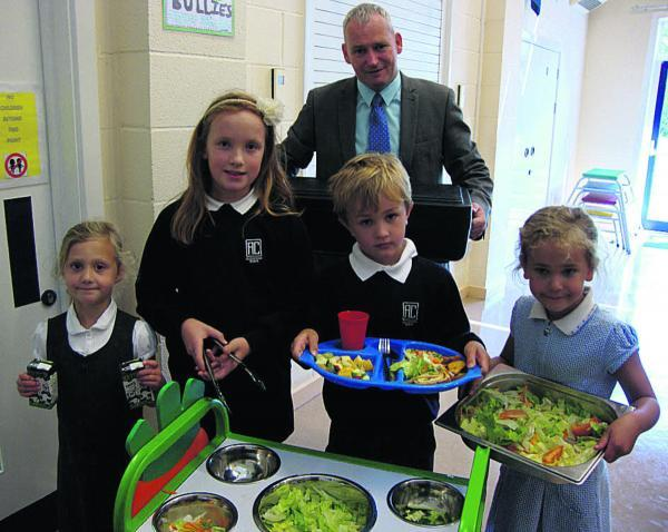 This Is Wiltshire: All Cannings head teacher Richard Borman with pupils and their healthy lunch