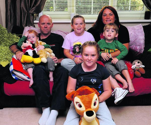 This Is Wiltshire: Olivia Fleming with Connor, Emily, Ashton, dad Adrian and mum Shona