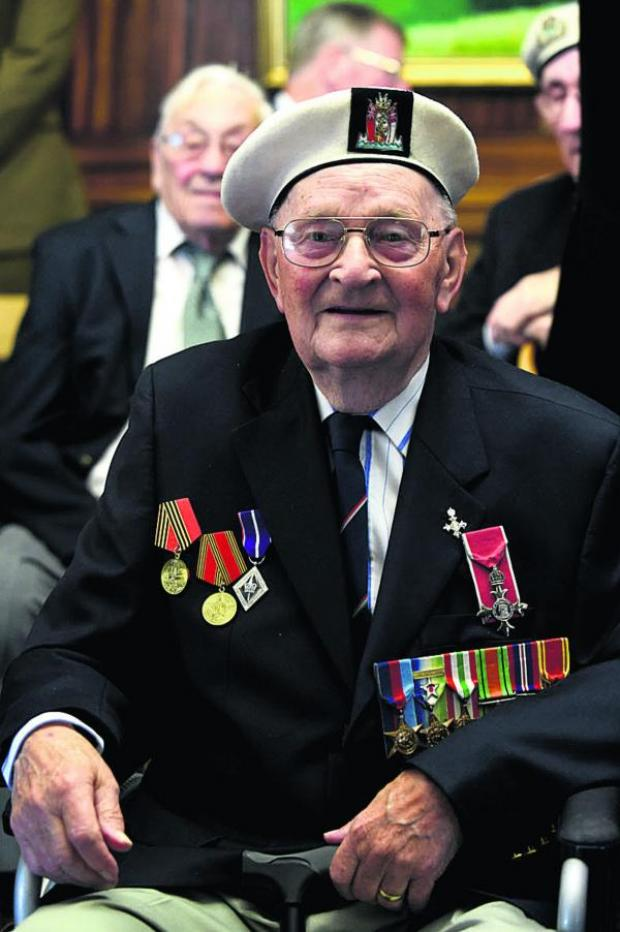 This Is Wiltshire: Ken Beard from Luggershall wears his medals with pride