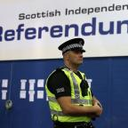 This Is Wiltshire: A police officer stands in the Highland Hall at the Royal Highland Centre during the count for the Scottish Referendum