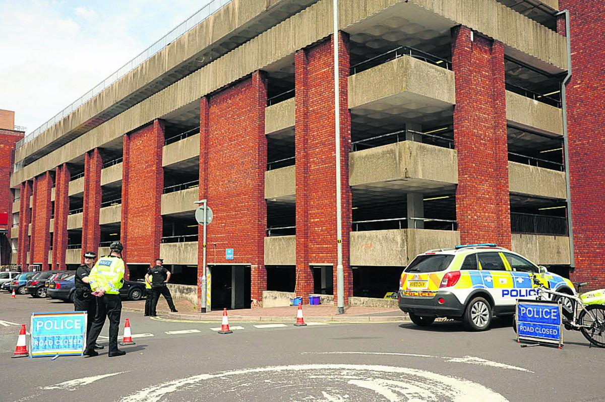 Police outside the multi-storey car park after Mr Wyllie's fall in June this year