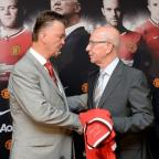 This Is Wiltshire: Sir Bobby Charlton, pictured right, was present at Louis van Gaal's unveiling as manager last July