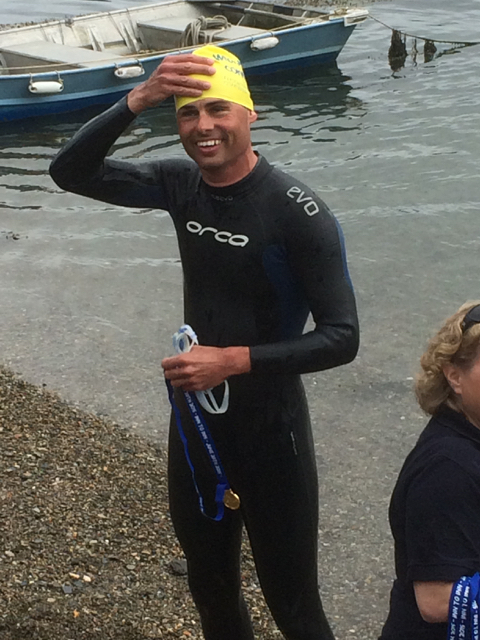 Broad smiles as Mark Rickaby celebrates the end of his swim