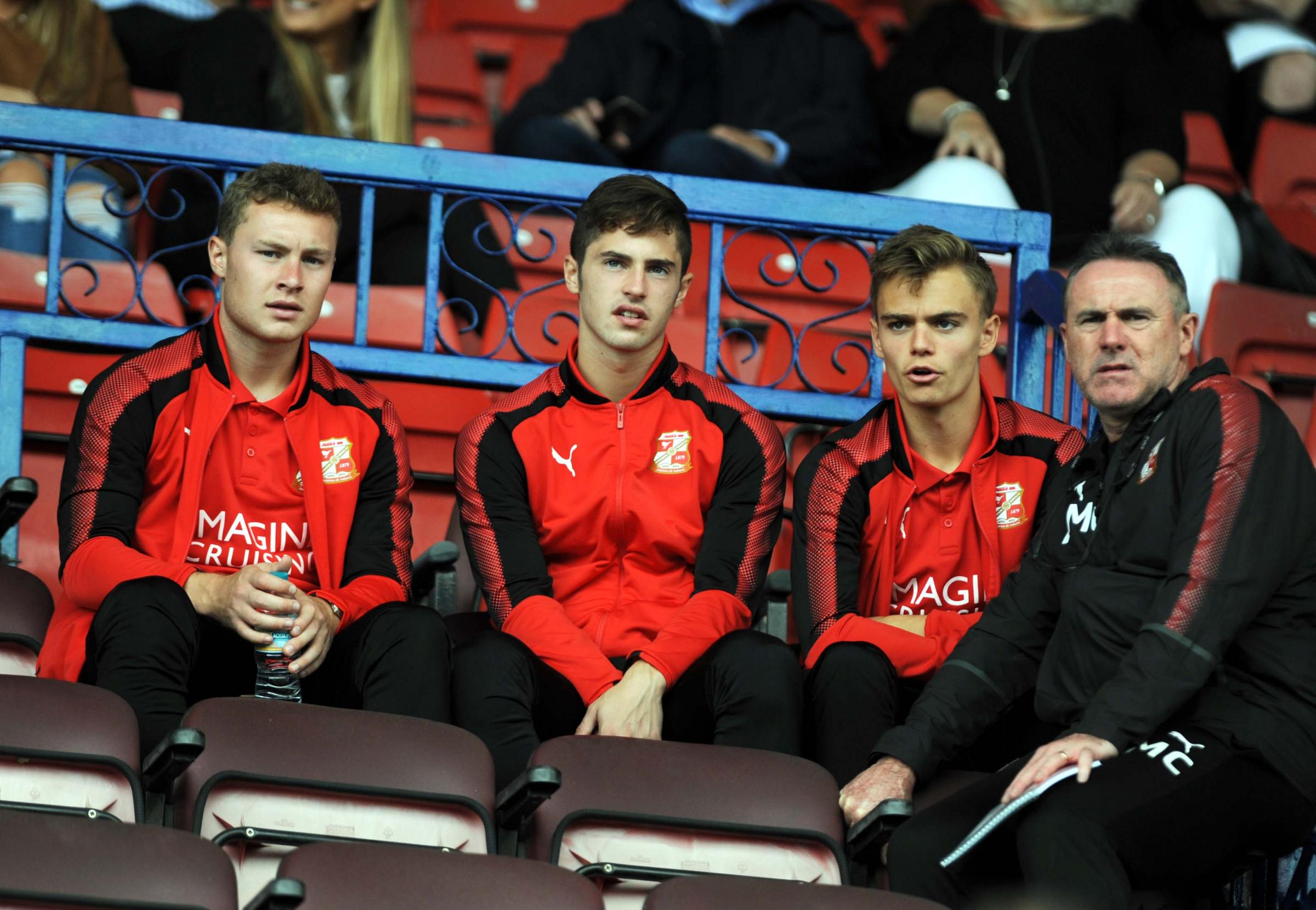 Alan McLoughlin (right) and some of Swindon Town's younger players