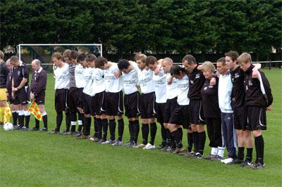 The Calne players observe a minute's silence in memory of club chairman Brian Hillier