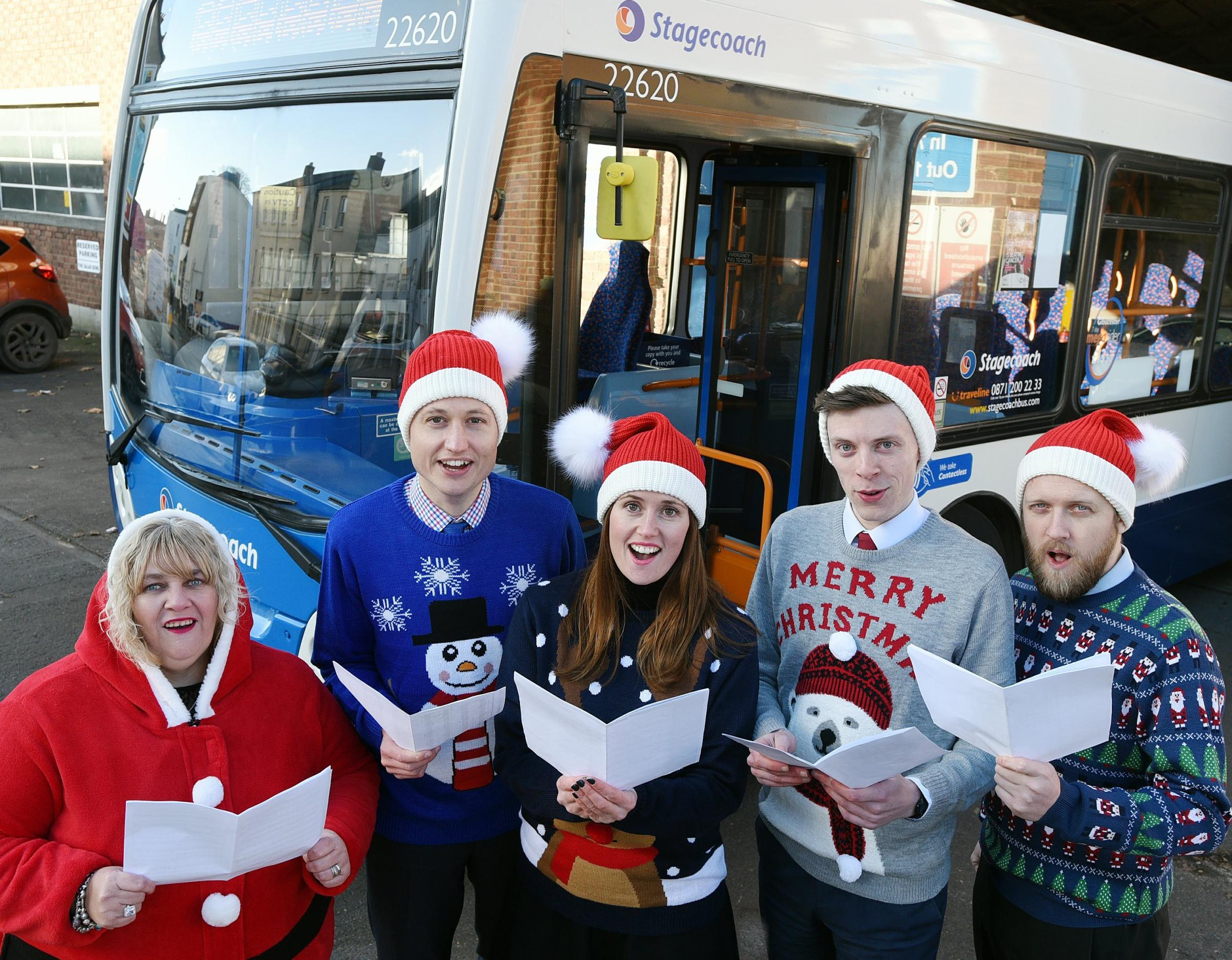 Carol singers from Stagecoach West:  Rupert Cox MD (second from left), Rachel Geliamassi, Operations Director, Vikki Stiles. Customer Services and James Heaney and Mike Porrell, Commercial Officers.