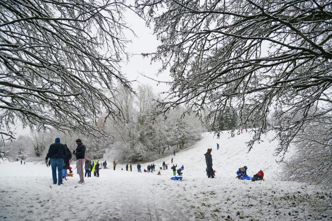 Families enjoying the snow at Coate Water in 2017 Picture: THOMAS KELSEY