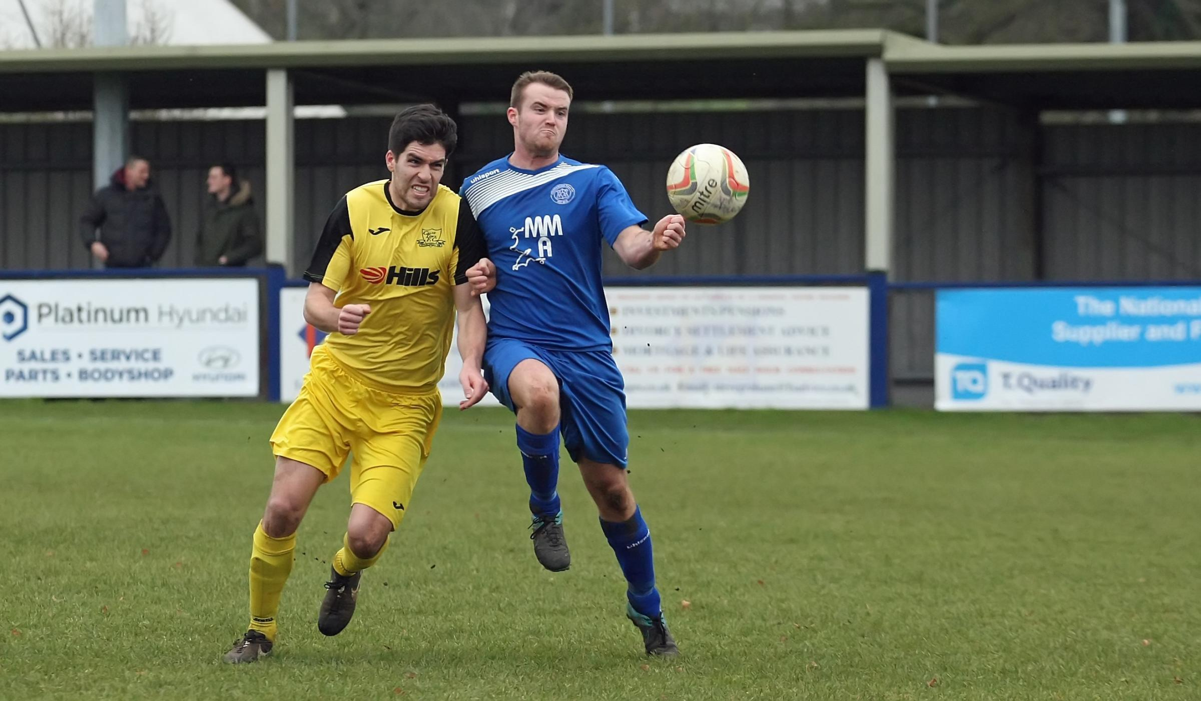Calne's Matthew Bearne (yellow) and Chippenham Park's Dan Heavy challenge for the ball during today's derby at Hardenhuish Park (Picture: ROBIN FOSTER)