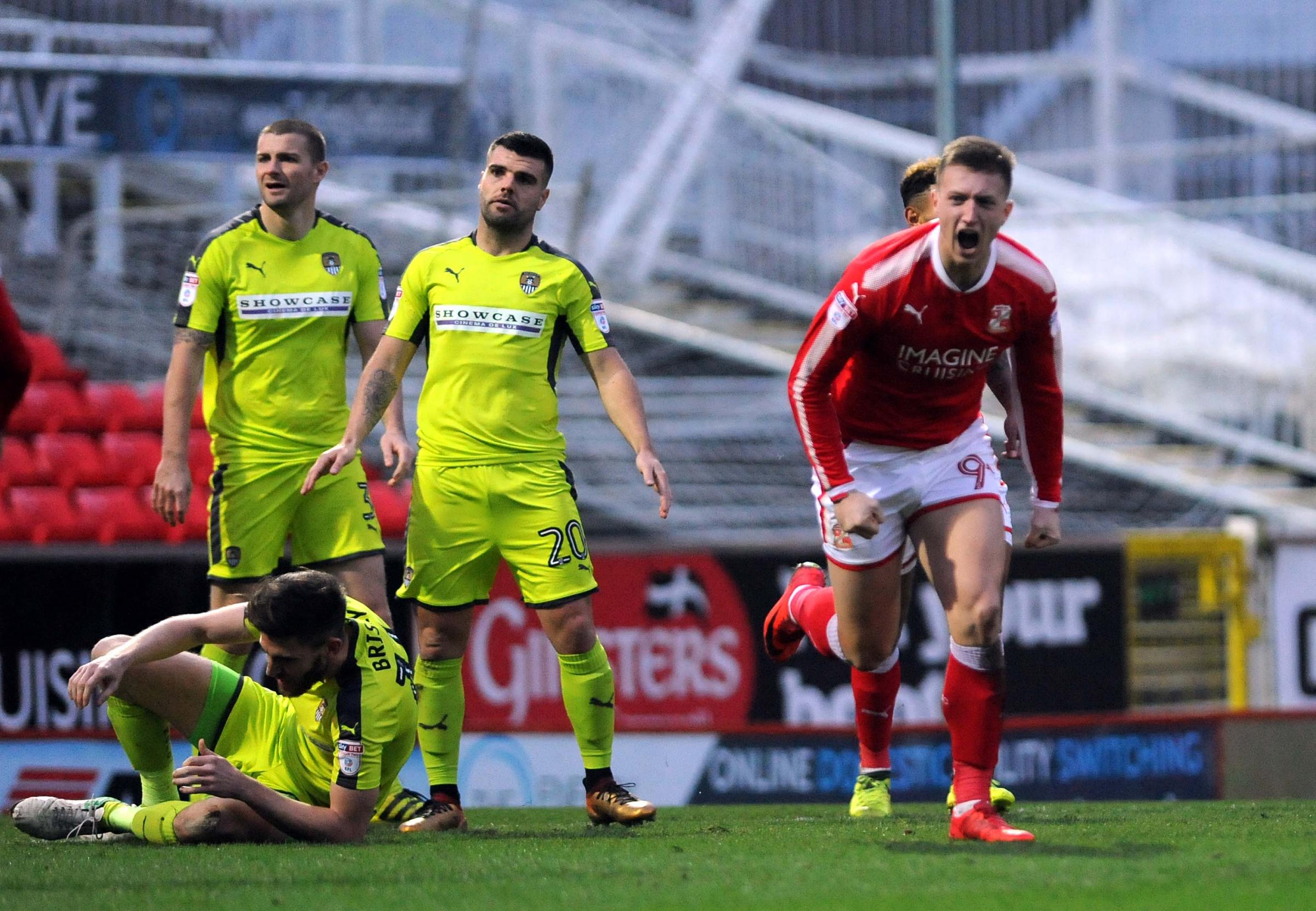 Luke Norris roars with delight after netting Swindon Town's winner against Notts County. PICTURE: DAVE EVANS
