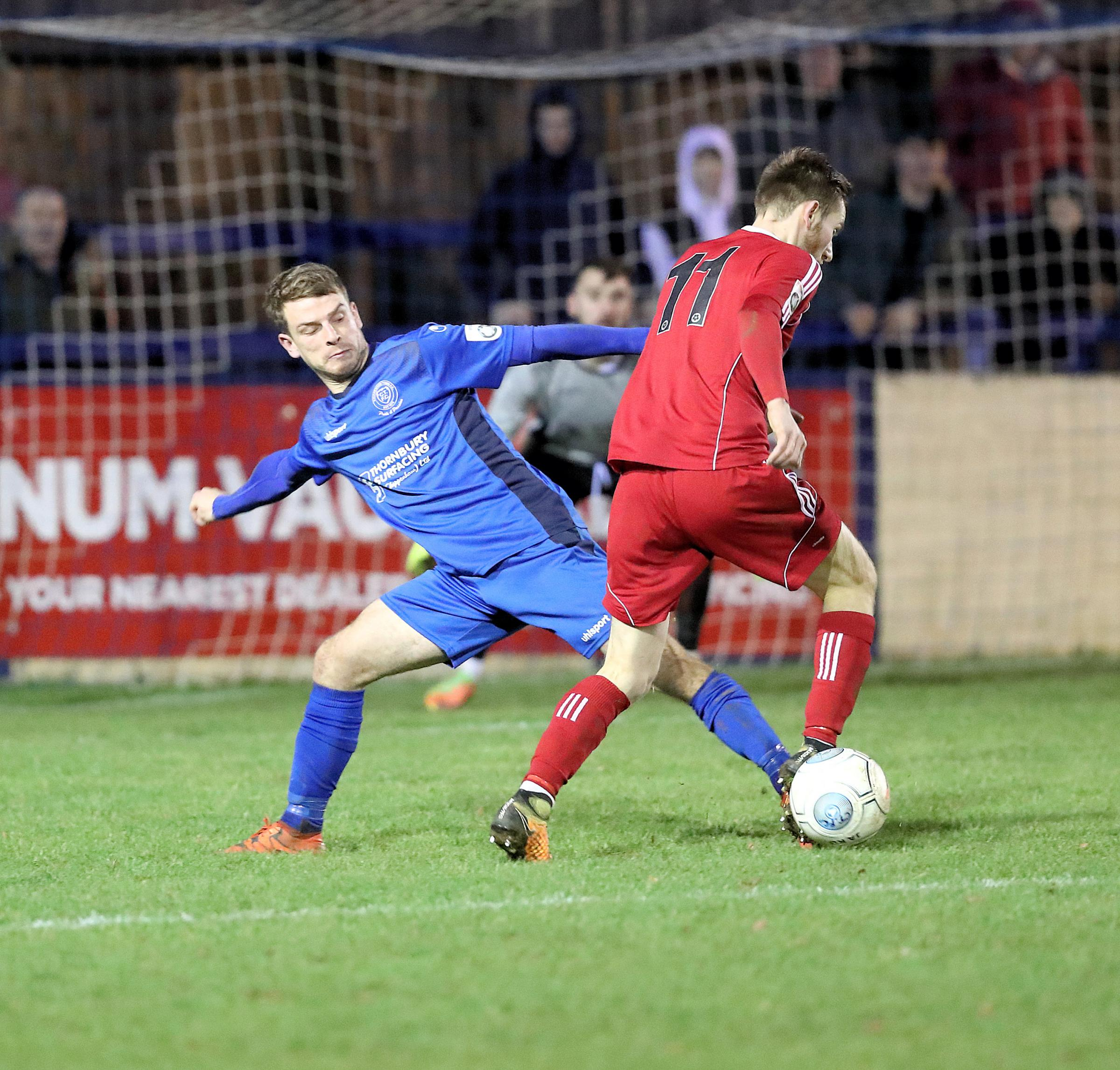 Chippenham Town's Alex Ferguson (blue) battles for the ball during the 2-1 defeat at home to Hungerford Town. PICTURE: RICHARD CHAPPELL
