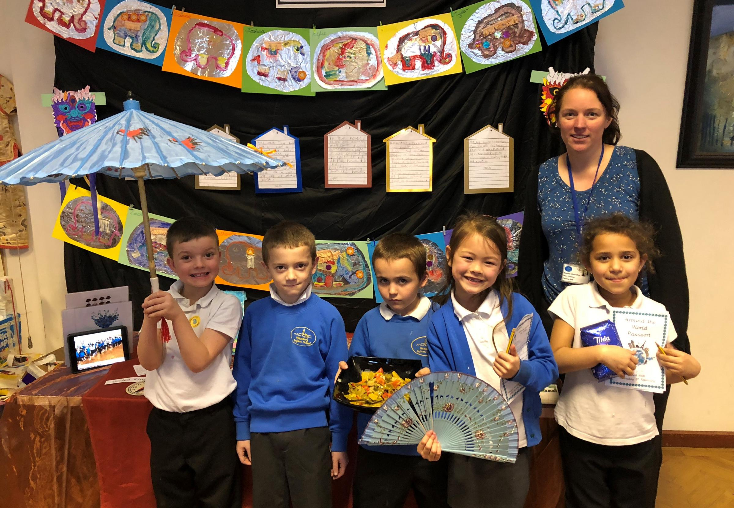 Westbury Infant School Pupils with teacher Elizabeth Channon and one of their around the world displays.