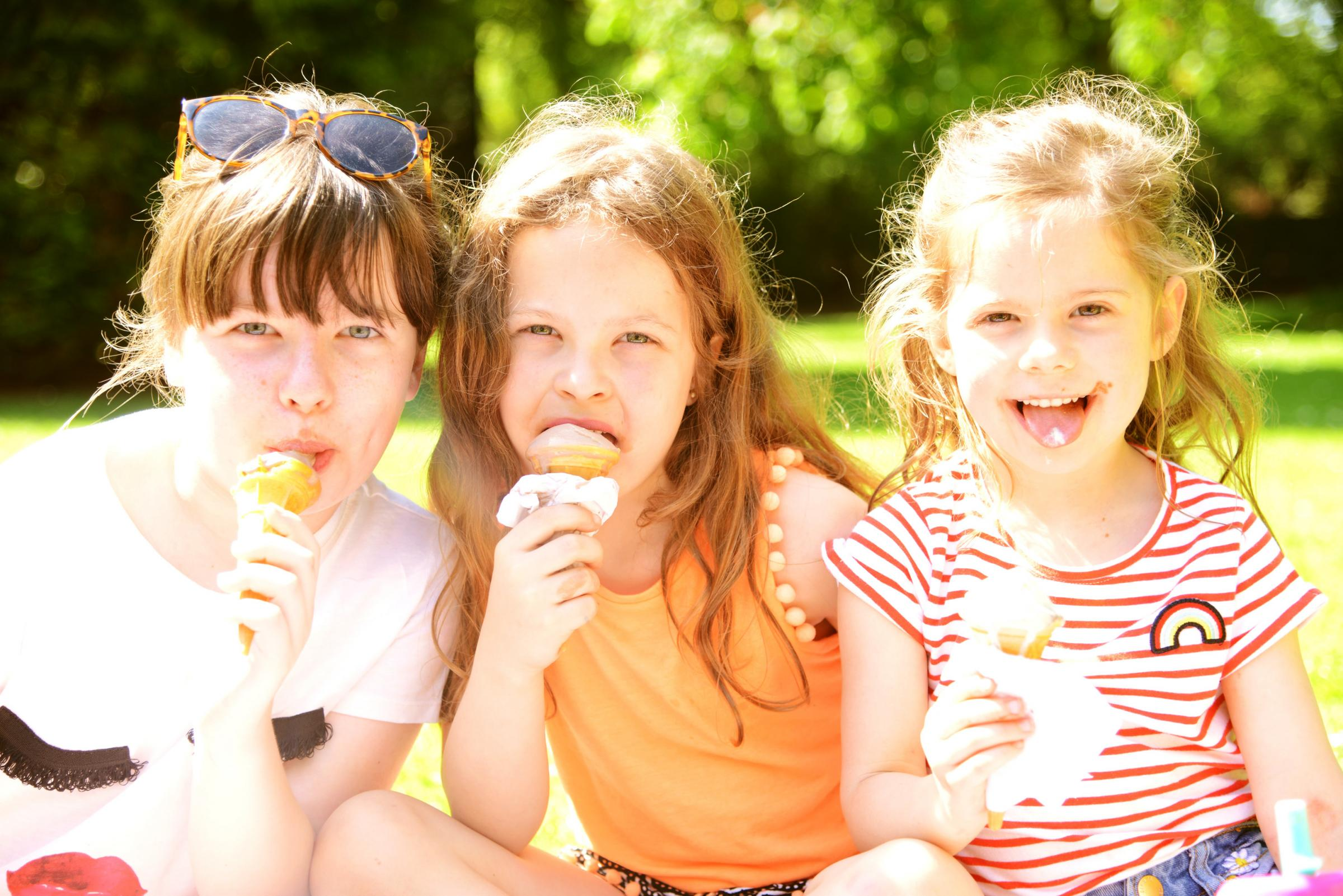 Matilda, Josie and Dolly enjoy ice cream at Town Gardens. Picture: THOMAS KELSEY