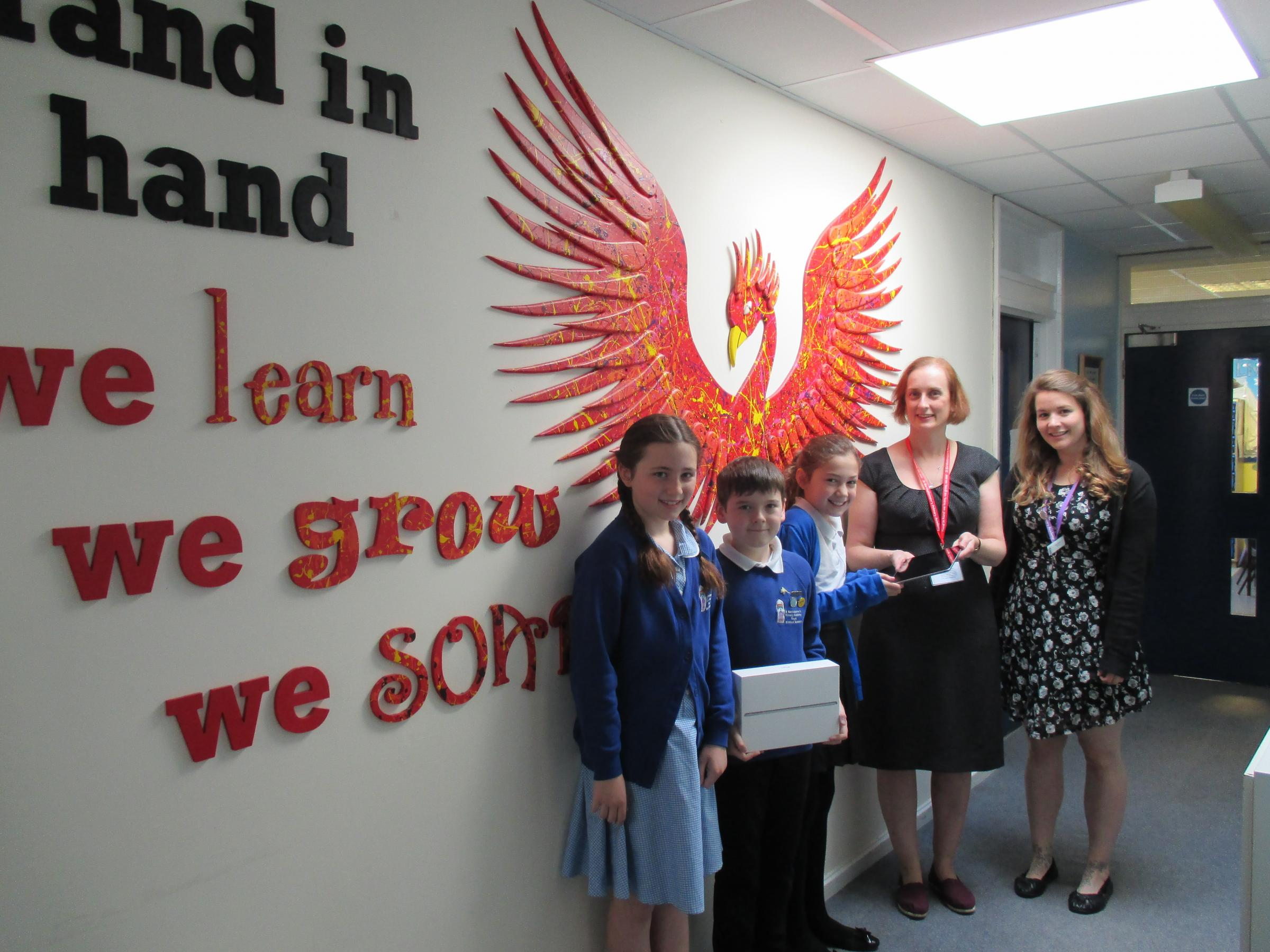 Digital Leaders Jessica, Jack and Emily with Haine and Smith manager Lisa Hall and teacher Mrs Shiles