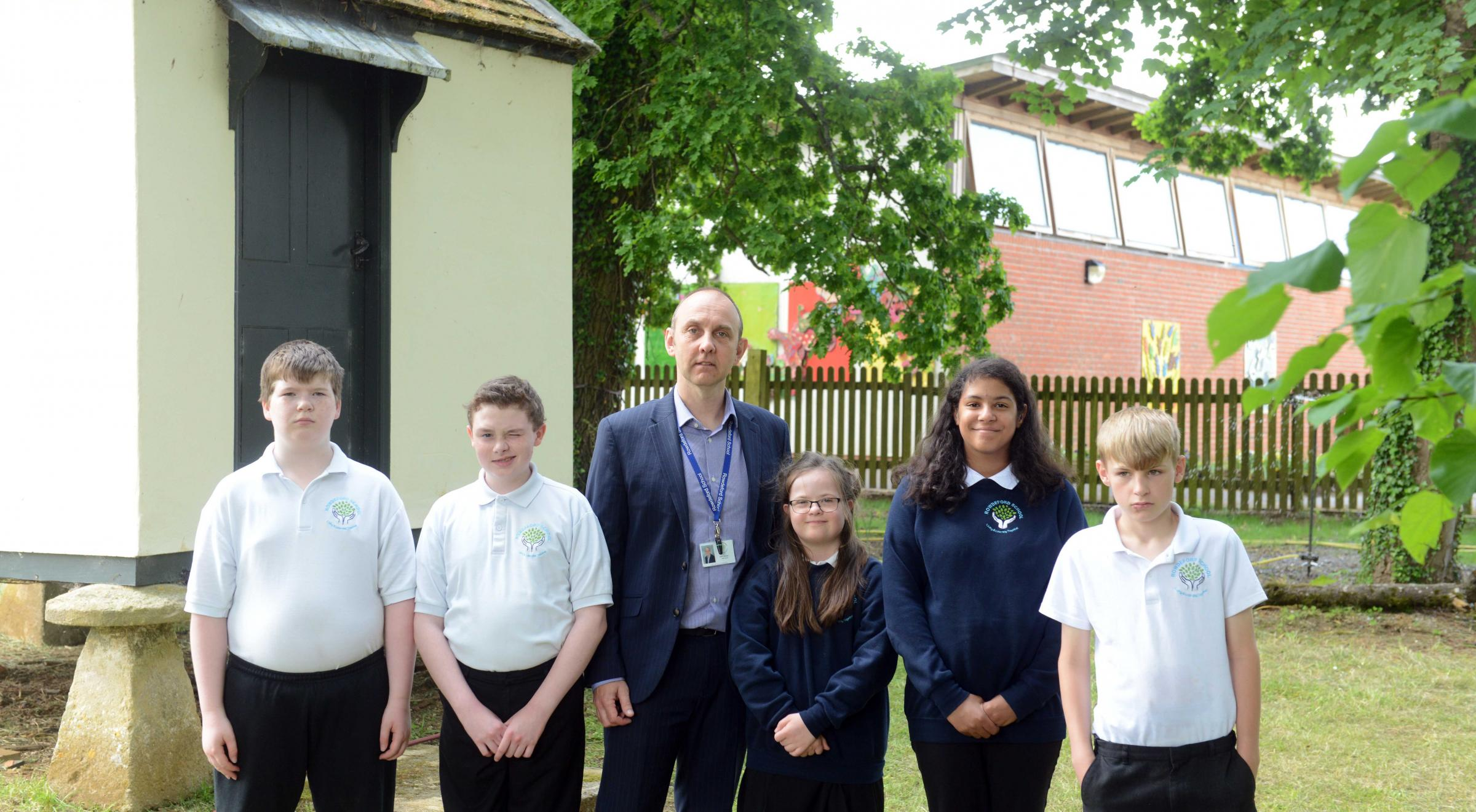 Rowdeford School under threat of closure.  Photo: Siobhan Boyle SMB2433/2  Pictured with head teacher Mike Loveridge are pupils l-r Sam, Isaac, Laura, Aliyah and Nathan