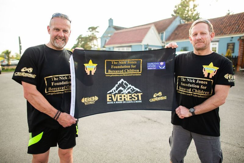 Nick Jones (left) with climbing partner Kerry Wilson proudlty display their foundation flag.
