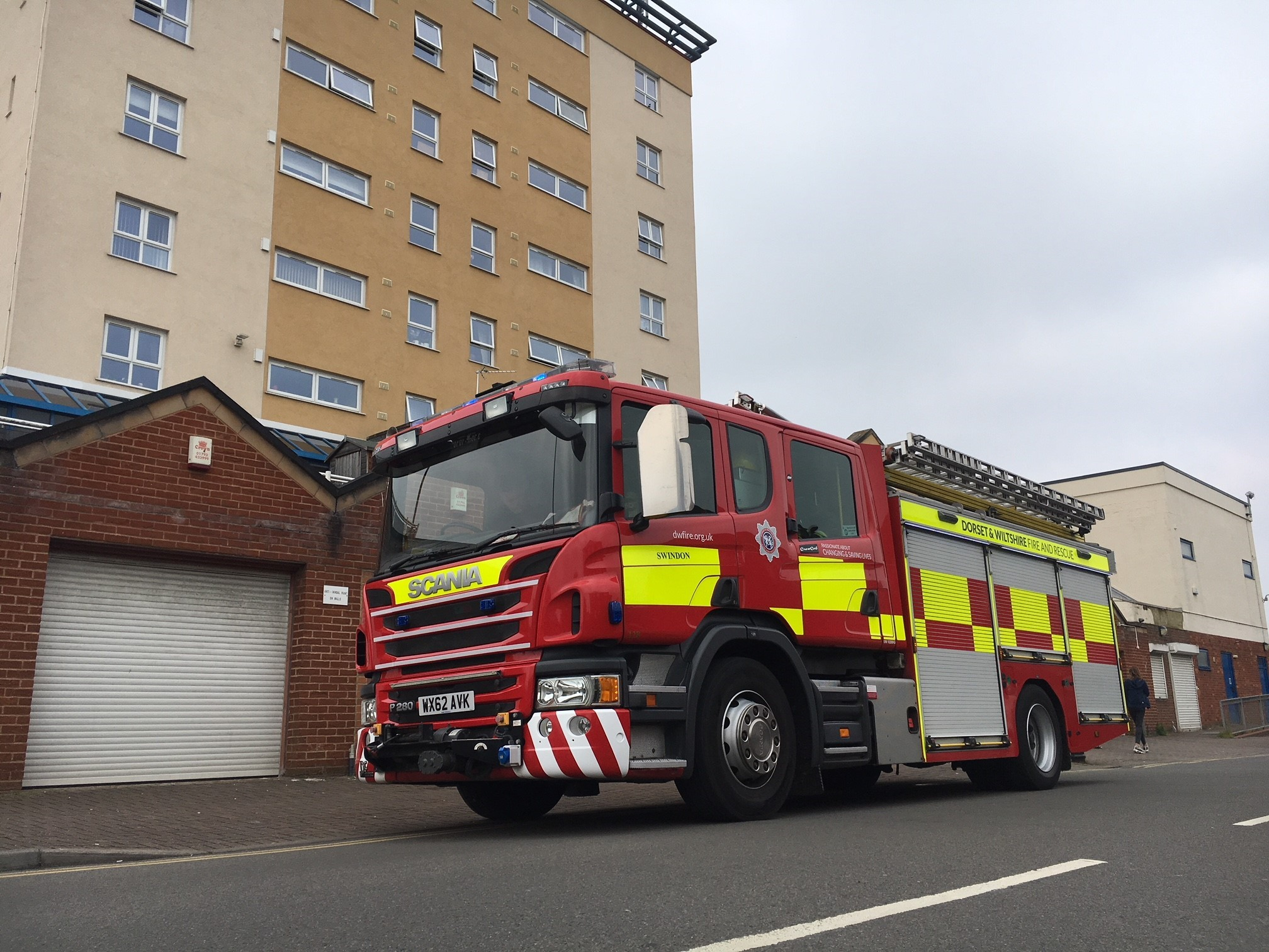 A crew from Swindon fire station outside George Hall Court, Park South.