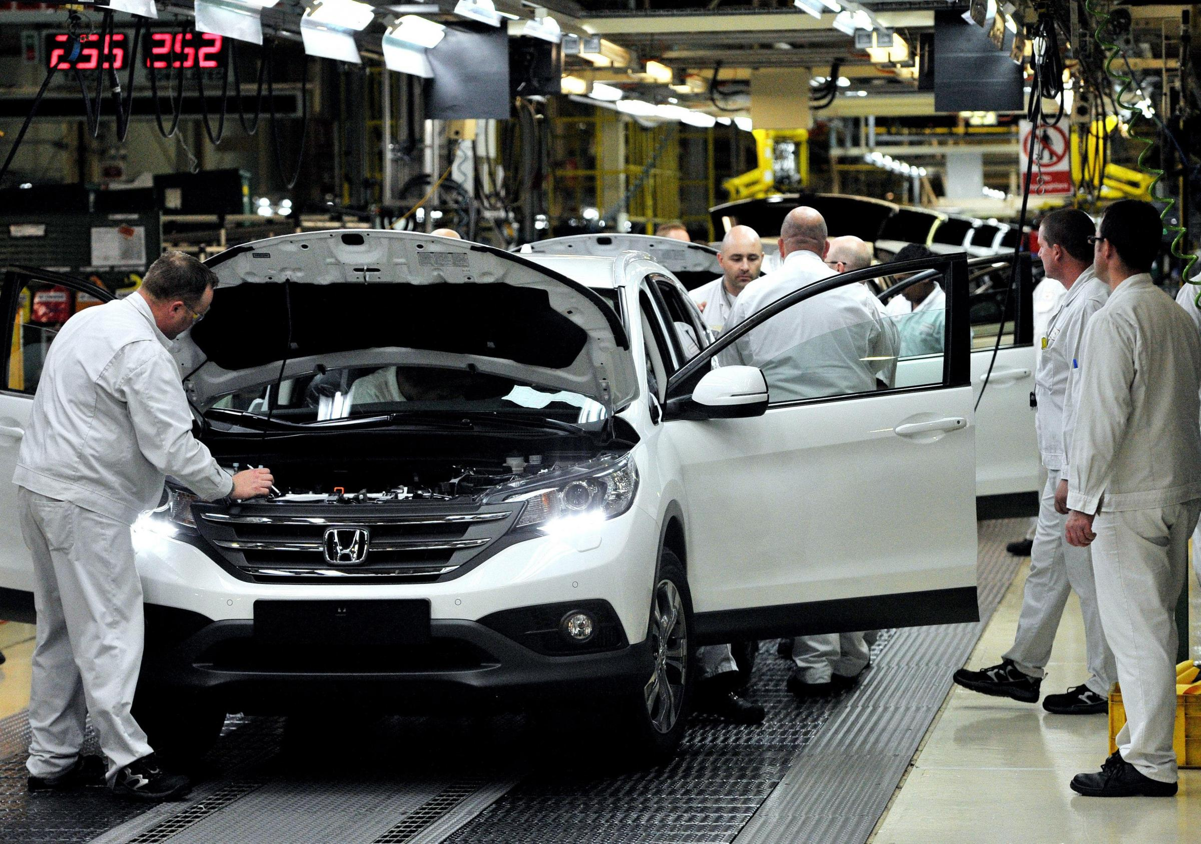 File photo dated 06/09/12 of workers on the Honda CR-V production line at the Honda Plant in Swindon. Honda is to cut 800 jobs at the plant after a slump in demand accross Europe..