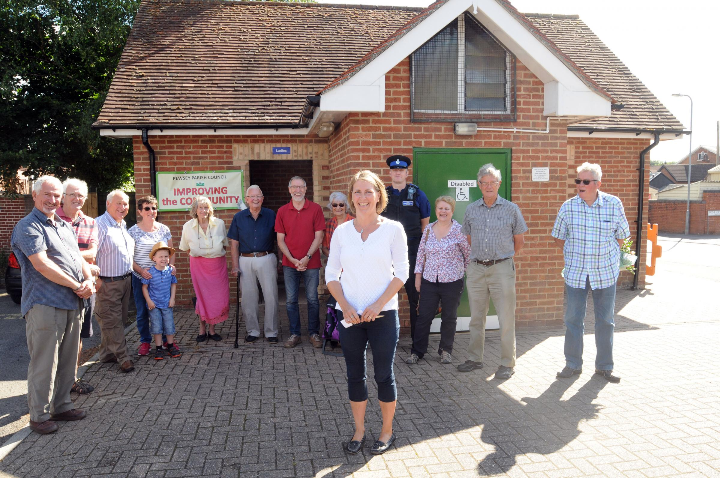 Susie Brew (front)  declares the newly refurbished toilets in Pewsey open Photo: Siobhan Boyle SMB2493/2.