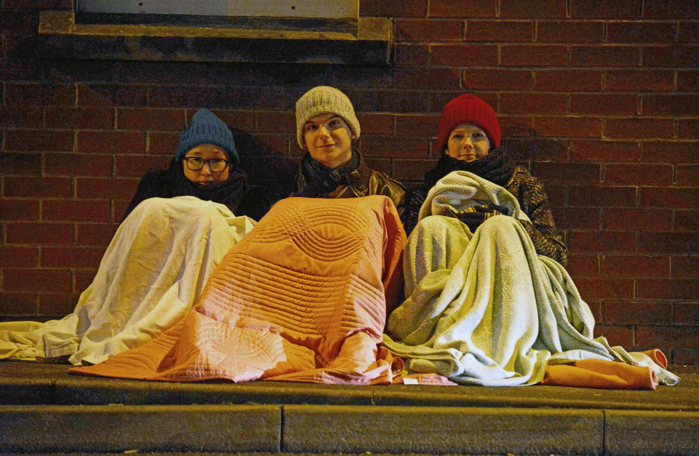 Thomas Kelsey 07/12/12.Threshold housing are holding a sleepout tonight. Pictured Kay Larkins, Jonothan Law and Jenny Collins..