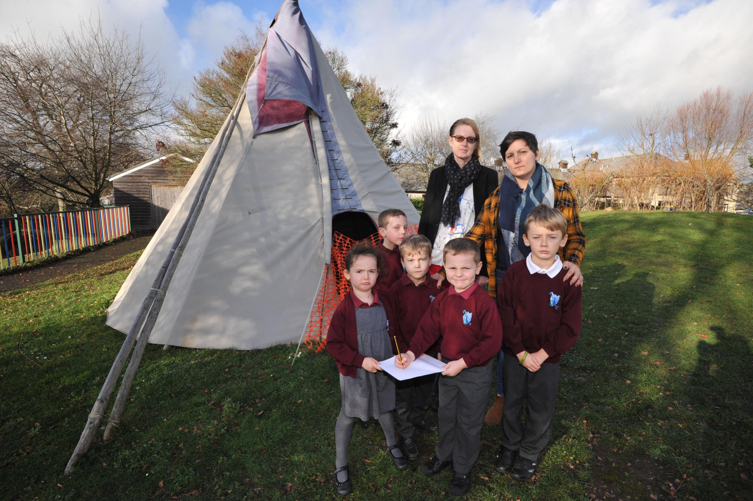 Fitzmaurice Primary School appeal. Head  Tracey Dunn with fund appeal parent Emma  Louise Poursain with pupils Erin,  Lewis, Dylan, Euan and Dennis listing the damage done to the school Teepee. Photo Trevor  60086 1..
