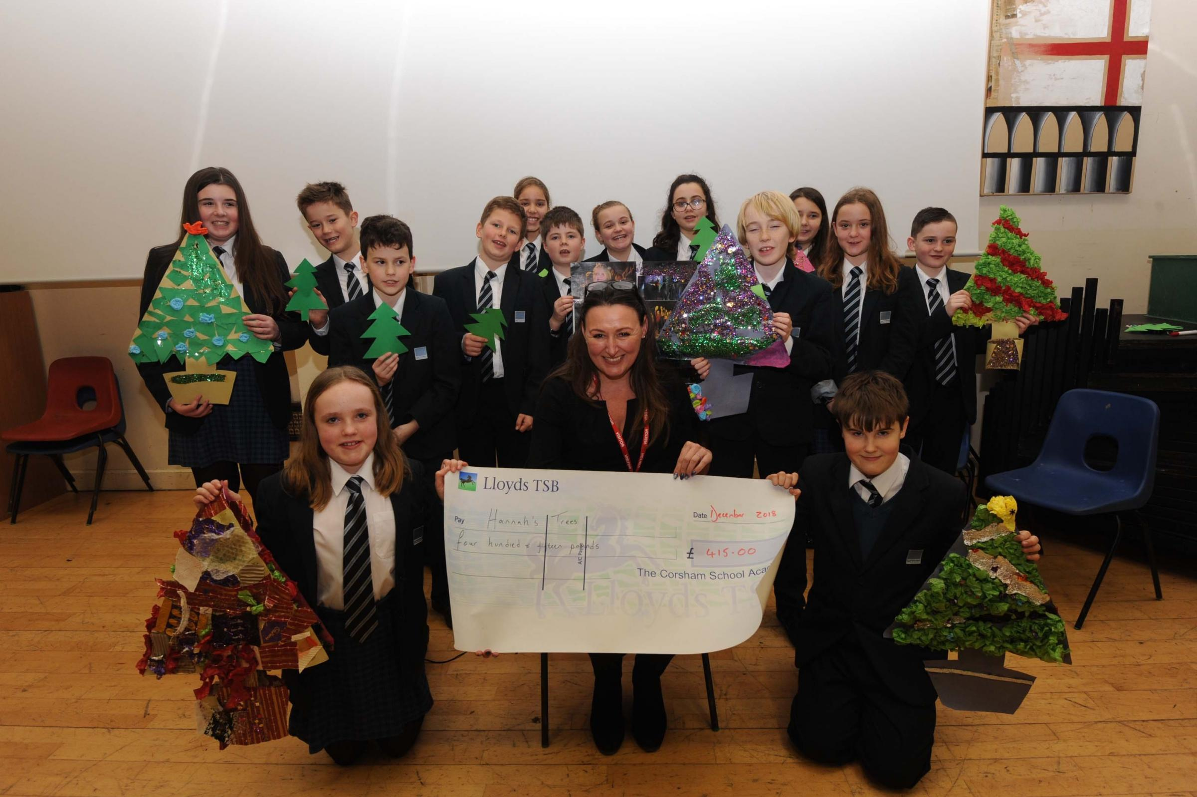 Christine Lamb receives the cheque for charity Hannah's Trees from year seven at Corsham School. Picture: Trevor Porter