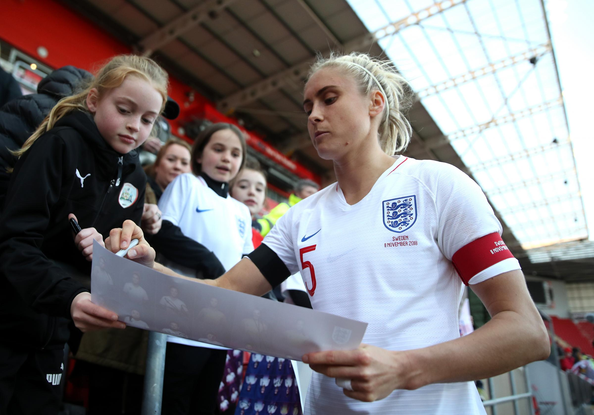 England's Steph Houghton signs autographs after the final whistle during the Women's International Friendly match at the AESSEAL New York Stadium, Rotherham.