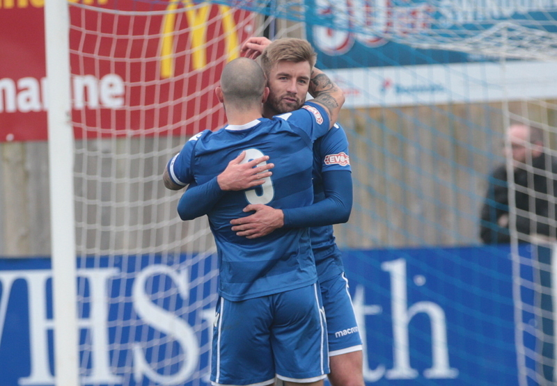 Stuart Fleetwood embraces Swindon Supermarine goalscorer Connor McDonagh (right) during the 1-1 draw at home to Poole Town on Saturday. PICTURE: JEFF YOUD