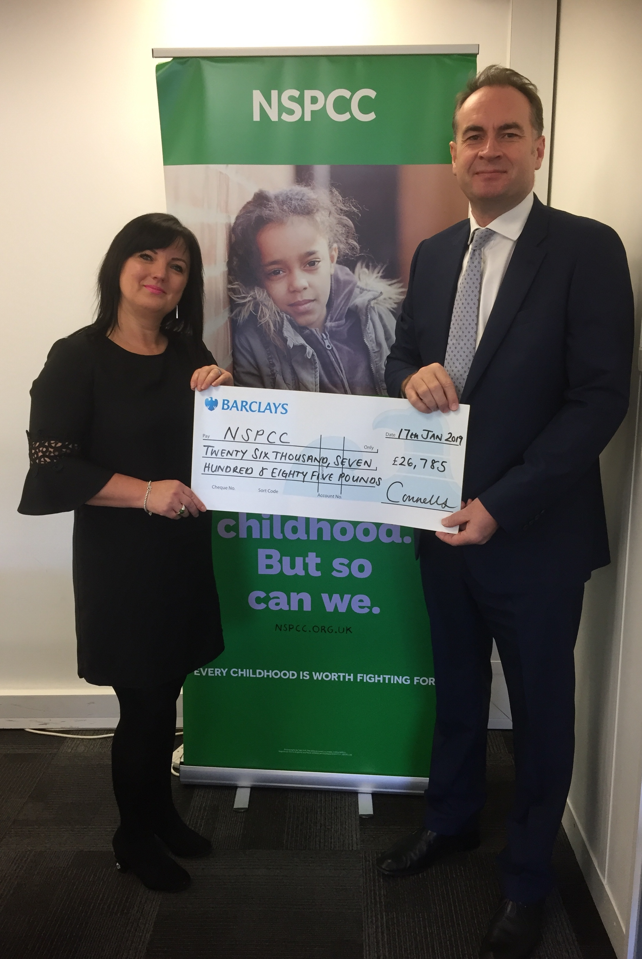 Connells Estate Agency Chief Executive David Plumtree presents the cheque to the NSPCC