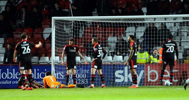 The Swindon Town players show their frustration after going a goal behind during their 2-0 defeat at Stevenage in League Two last night          Picture: DAVE EVANS