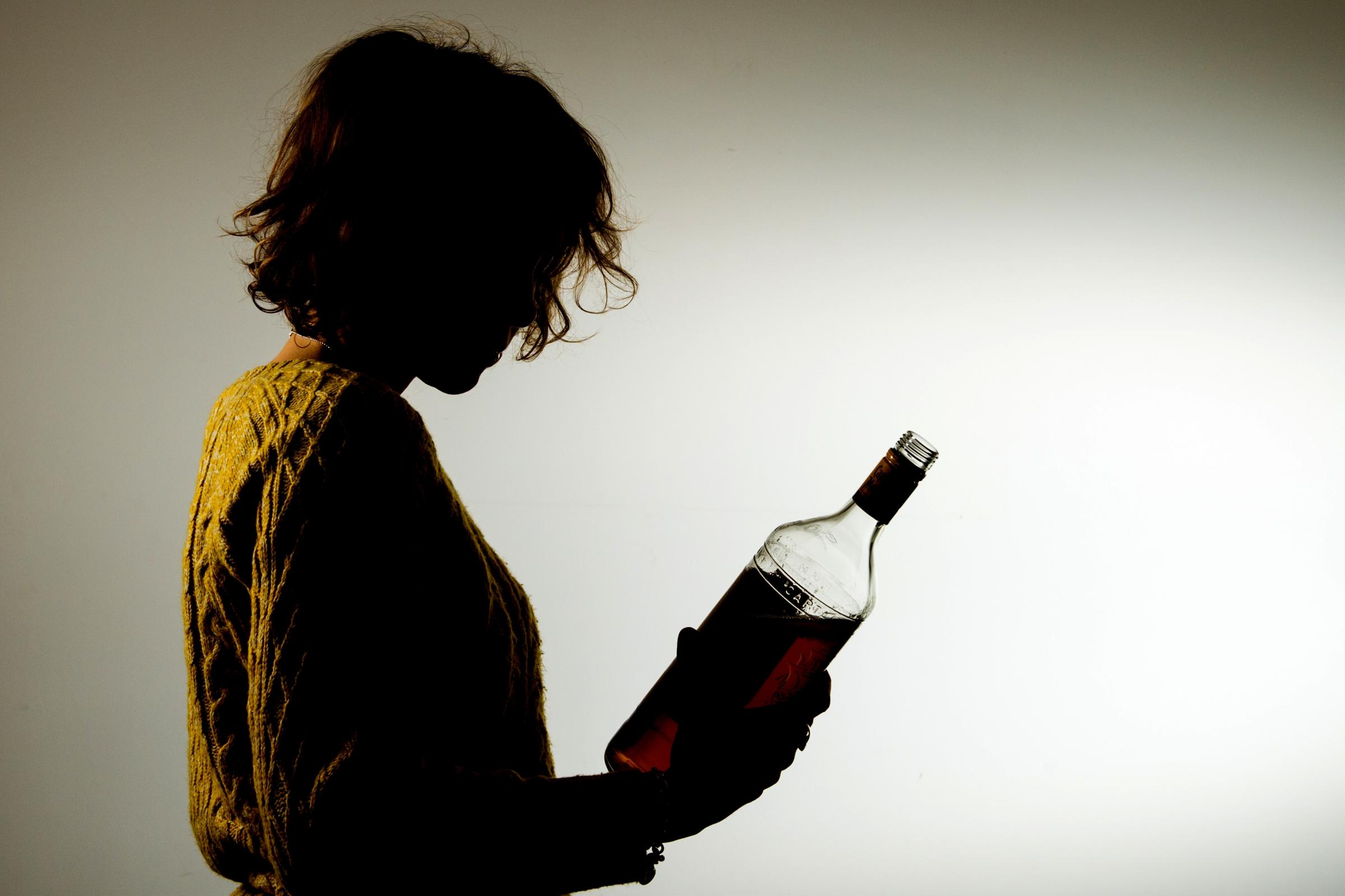 Women with bottle of alcohol