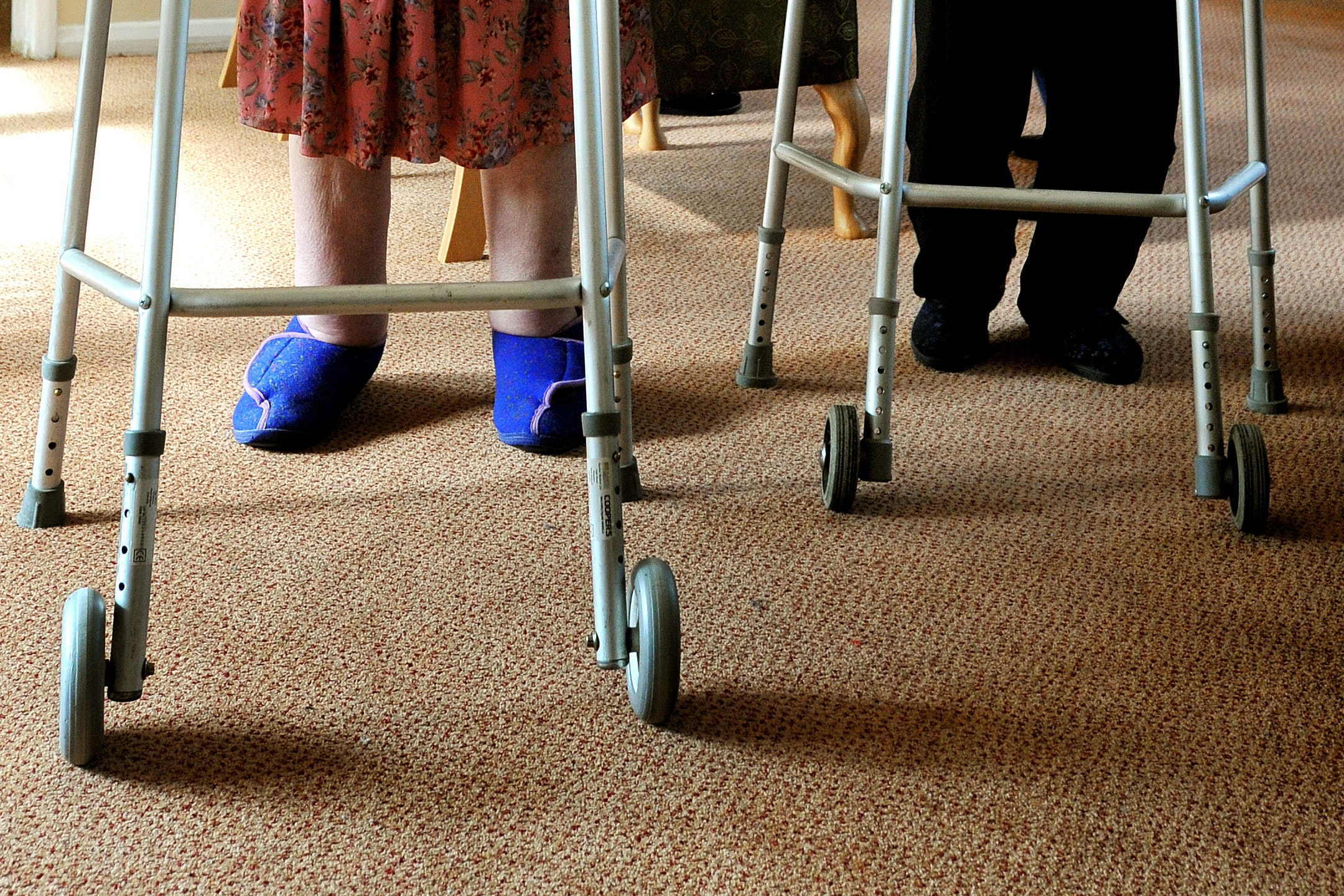 Elderly people using zimmer frames