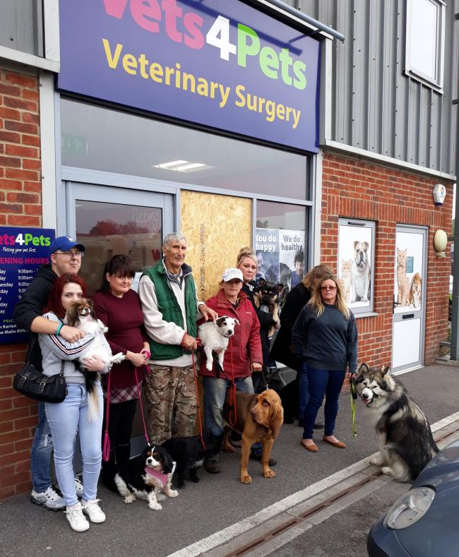 Pet owners outside the vets in Marlborough demonstrating their demands to keep the practice open