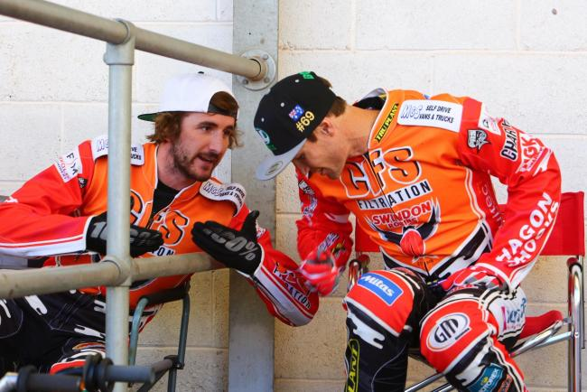 Swindon Robins riders Adam Ellis and Jason Doyle in discussion during tonight's meeting at Belle Vue Aces. PICTURE: LES AUBREY