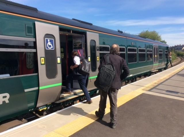 Passengers board a train at Melksham railway station